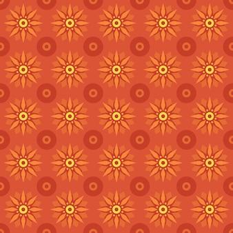 古典的なバティックのシームレスなパターン背景。豪華な幾何学的なマンダラの壁紙。オレンジ色のエレガントな伝統的な花のモチーフ