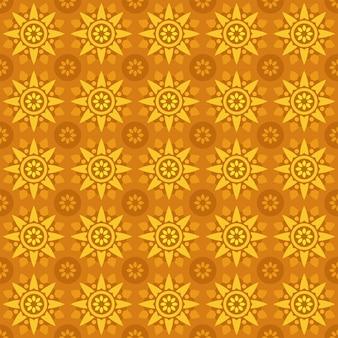 古典的なバティックのシームレスなパターン背景。豪華な幾何学的なマンダラの壁紙。オレンジイエローカラーのエレガントな伝統的なフローラルモチーフ