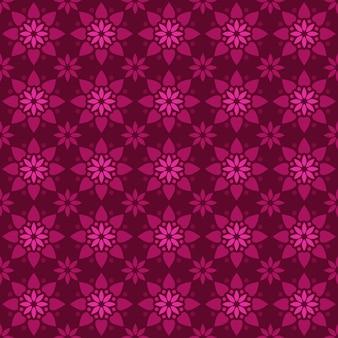 古典的なバティックのシームレスなパターン背景。豪華な幾何学的なマンダラの壁紙。ピンクのマゼンタ色のエレガントなトラディショナルフローラルモチーフ