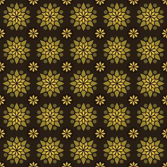 古典的なバティックのシームレスなパターン背景。豪華な幾何学的なマンダラの壁紙。イエローゴールドカラーのエレガントなトラディショナルフローラルモチーフ