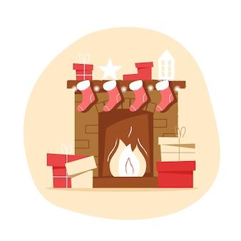 ニュートラルな背景にクリスマスソックスとギフトを備えたクラシックなレンガ造りの暖炉