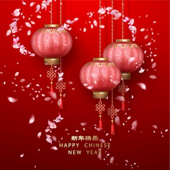 Classic chinese new year background. hanging silk lanterns and flying petals on red background