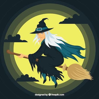 Classic witch with broom and full moon