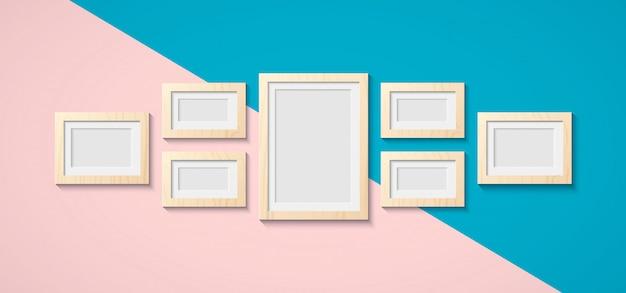 벽에 그림과 사진을위한 클래식 나무 프레임. 갈색과 흰색 나무 바닥에 빈티지 프레임 워크. 예술의 인테리어 디자인 및 개체 상징. 이미지를위한 공간을 복사하십시오.
