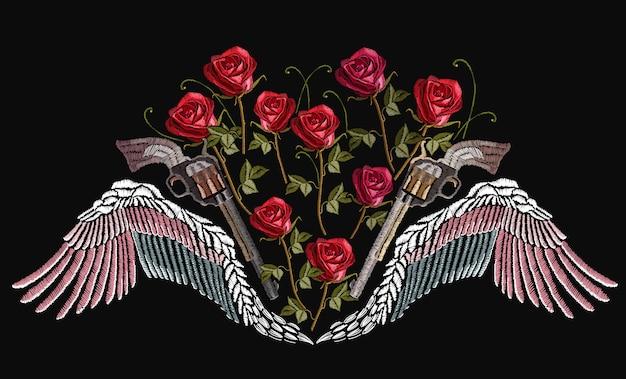 古典的な刺繍の翼と交差した銃