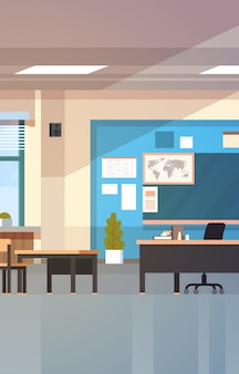 Classroom empty school class interior with chalk board desks and teacher table