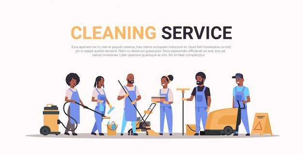 Cleaners team in uniform working together cleaning service concept male female   janitors using professional equipment  full length horizontal copy space