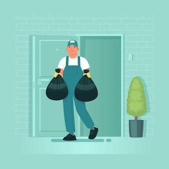 清掃サービス制服を着た男性社員が家やアパートからゴミ袋を取り出す