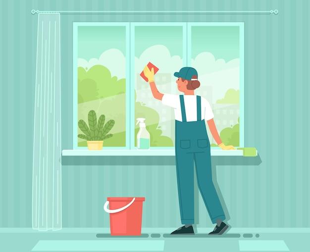 清掃サービス制服を着た女性クリーナーが窓を洗剤で洗う家のアパートの清掃