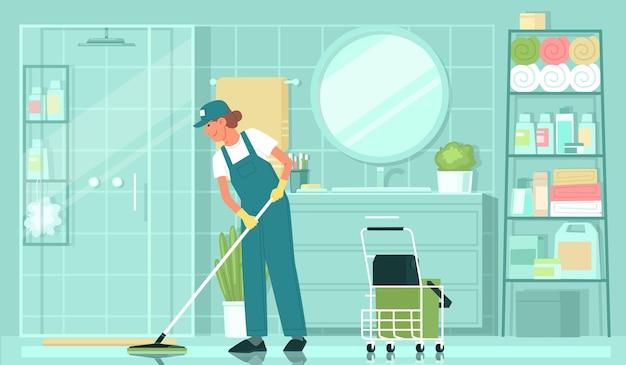 청소 서비스 제복을 입은 여성 청소부가 욕실에서 걸레로 바닥을 씻는다
