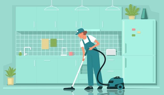 清掃サービス制服を着た女性クリーナー社員がキッチンの床を掃除機で掃除