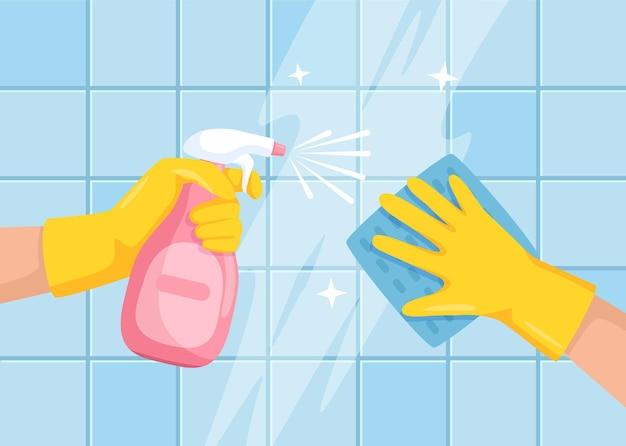 스프레이 병과 천으로 닦는 욕실 타일 벽 그림으로 표면 손 청소