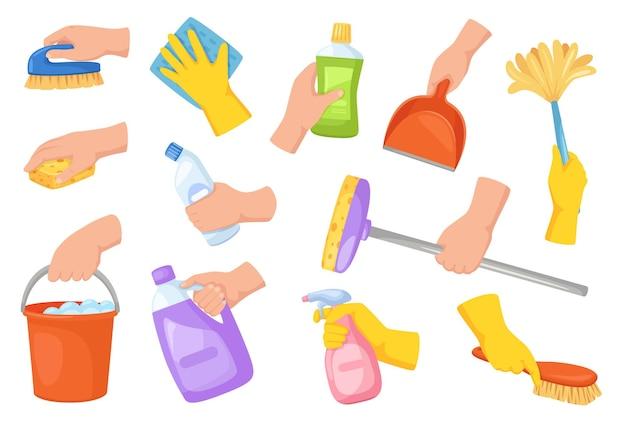 Cleaning tools in hands hand holding housekeeping equipment broom duster detergent scoop set