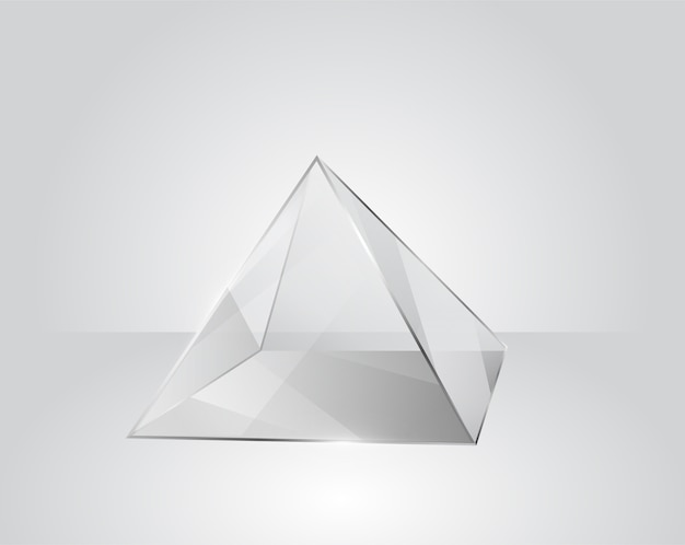 Clear glass pyramid on a modern gray background
