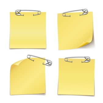 Close up blank sticky notes with safety pin on white background