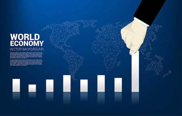 Close up businessman hand pull bar graph higher.
