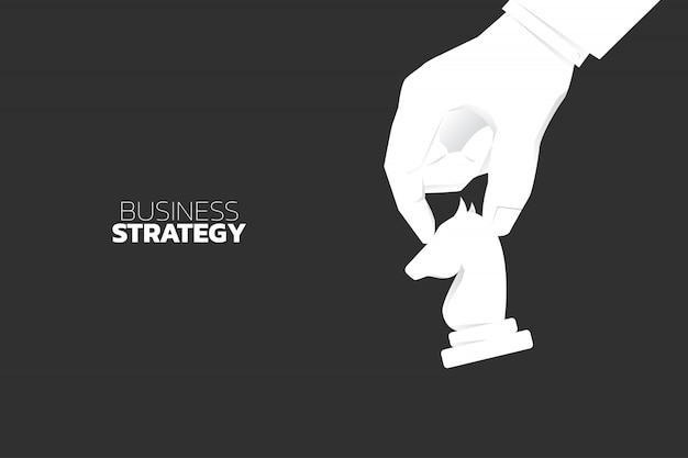 Close up hand move knight chess piece. concept of business strategy and marketing plan