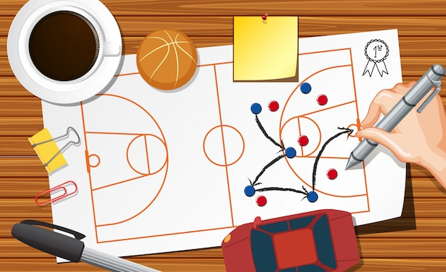 Close up hand writing basketball plane on paper with coffee cup on desk background