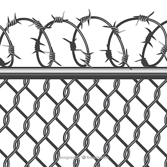 Close up of metal fence with barbed wire