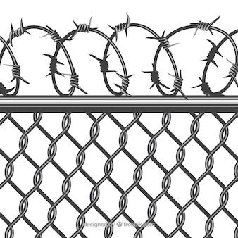 有刺鉄線で金属フェンスを閉じる