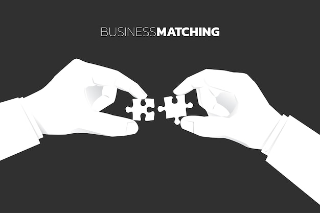 Close up two businessman hand put jigsaw piece to fit together. business concept  business