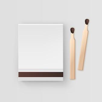 白い背景の上の一致のトップビューの閉じた空白の本