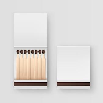 白い背景の上の一致の平面図の閉じた開いた空白の本