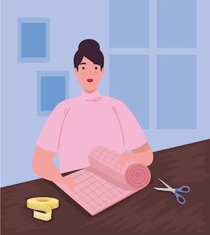 ピンクの布で服のデザイナー