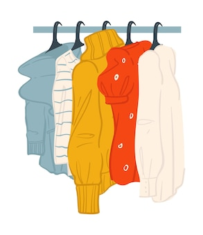 Clothes in fashion store or shop sweaters on sale