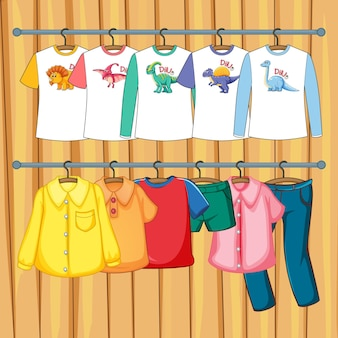 Clothes hanging on clothes rack on wooden wall background