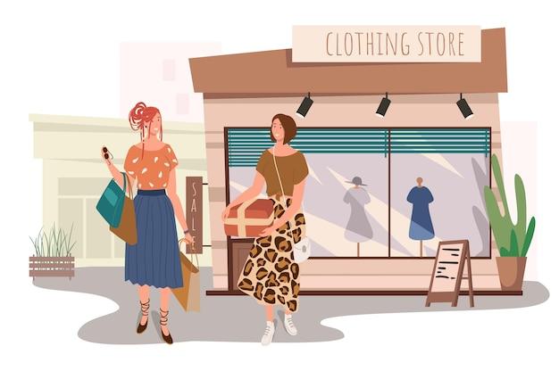 Интернет-концепция здания магазина одежды. две женщины покупают стильную одежду в бутике. подруги встречаются и ходят по магазинам вместе