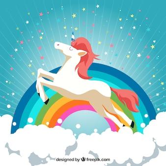 Nube e sfondo arcobaleno con felice unicorno