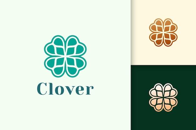 녹색 색상으로 추상 모양의 클로버 잎 로고는 행운이나 허브를 나타냅니다