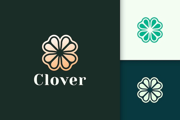 Clover leaf logo in luxury gold color represent lucky or herb
