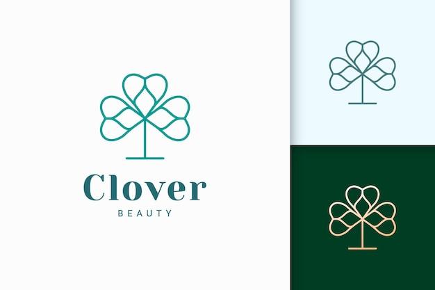 단순한 선과 사랑 모양의 클로버 로고는 행운을 나타냅니다.