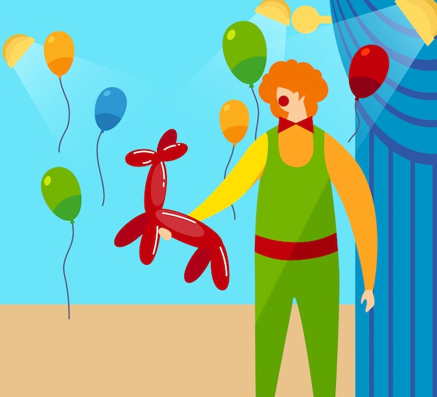 Clown holding in hands red balloon in shape of dog
