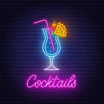 Cocktail blue hawaiian neon sign on brick wall background .