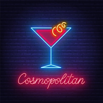 Cocktail cosmopolitan neon sign on brick wall background .