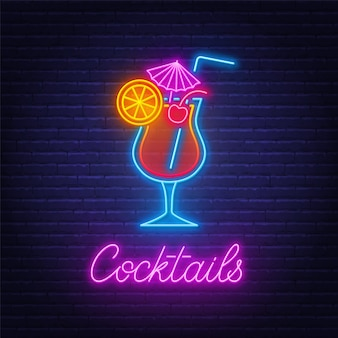 Cocktail tequila sunrise neon sign on brick wall background .