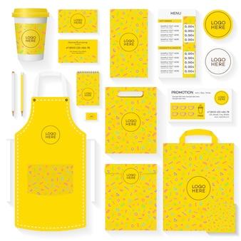 Шаблон фирменного стиля кофейни с желтым геометрическим узором в стиле мемфис