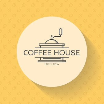 Логотип кофейни с кофемашиной на зернах