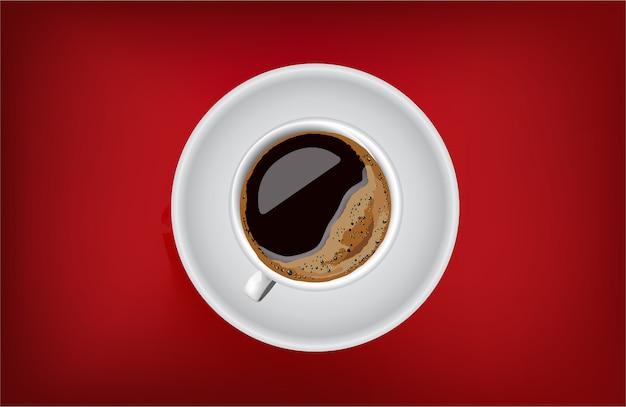 Coffee mug and saucer on red table