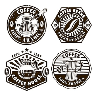Coffee set of four vector emblems, badges, labels or logos in vintage monochrome style isolated on white background