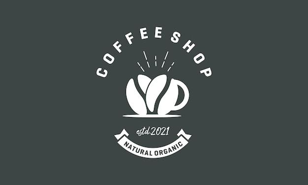 濃い灰色の背景に分離されたコーヒーショップのデザインロゴ