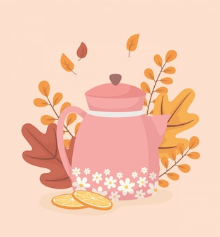 Coffee time and tea, tea pot woth flowers sliced orange and leaves background