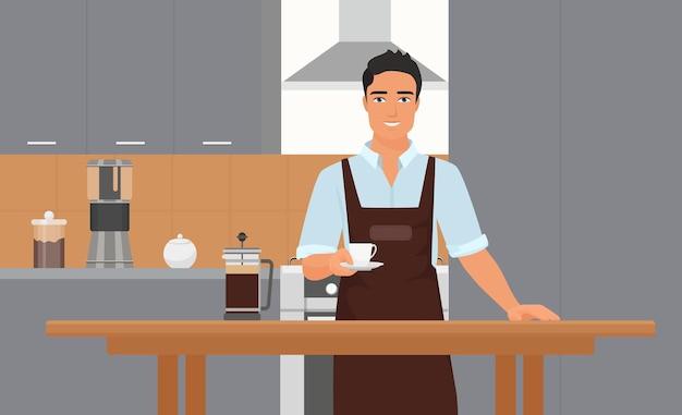 一杯のコーヒーを保持しているエプロンで笑顔の若いバリスタと喫茶店のキッチンインテリア