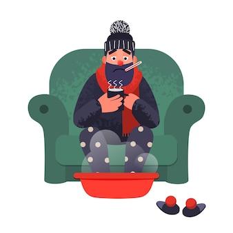 Человек простудного гриппа на диване с термометром