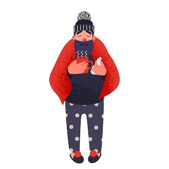 Холодный мужчина в одеяле держит чашку теплого чая