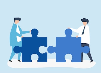 Colleagues connecting jigsaw pieces together
