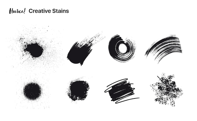 Collection of black paint strokes of different shapes made with dry brush